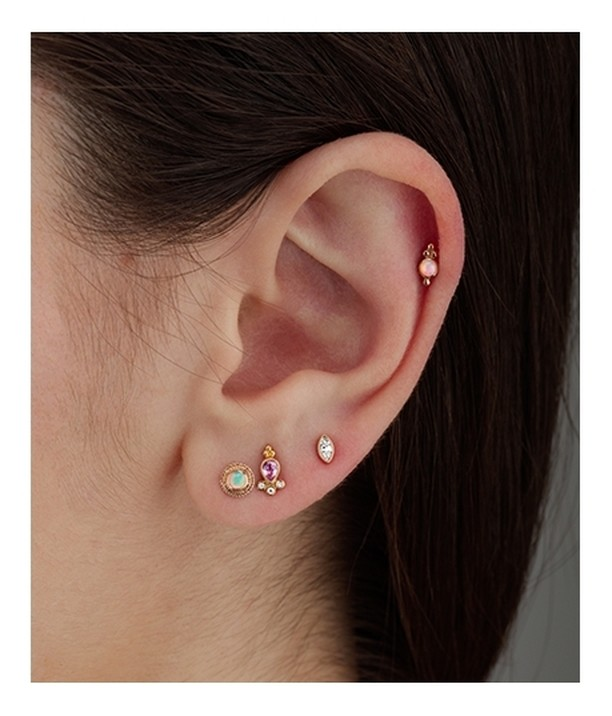 5d1d369f1 A medly of stones - the pink sapphire delia stud and diamond marquise rest  in the earlobe contained between the an opal gold braid stud in the lobe  and the ...