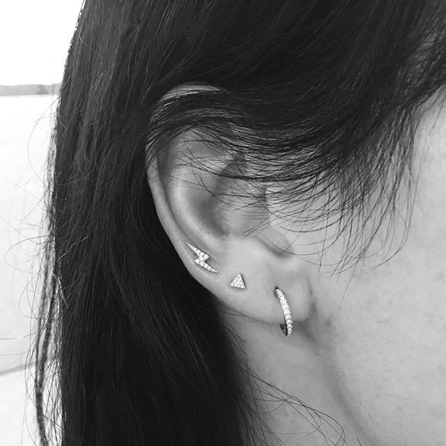 f9d922fe6 Even in black and white, the piercing Diamond Lightning Bolt shines  through! This look also features a Diamond Eternity placed carefully in the  ear's lobe.